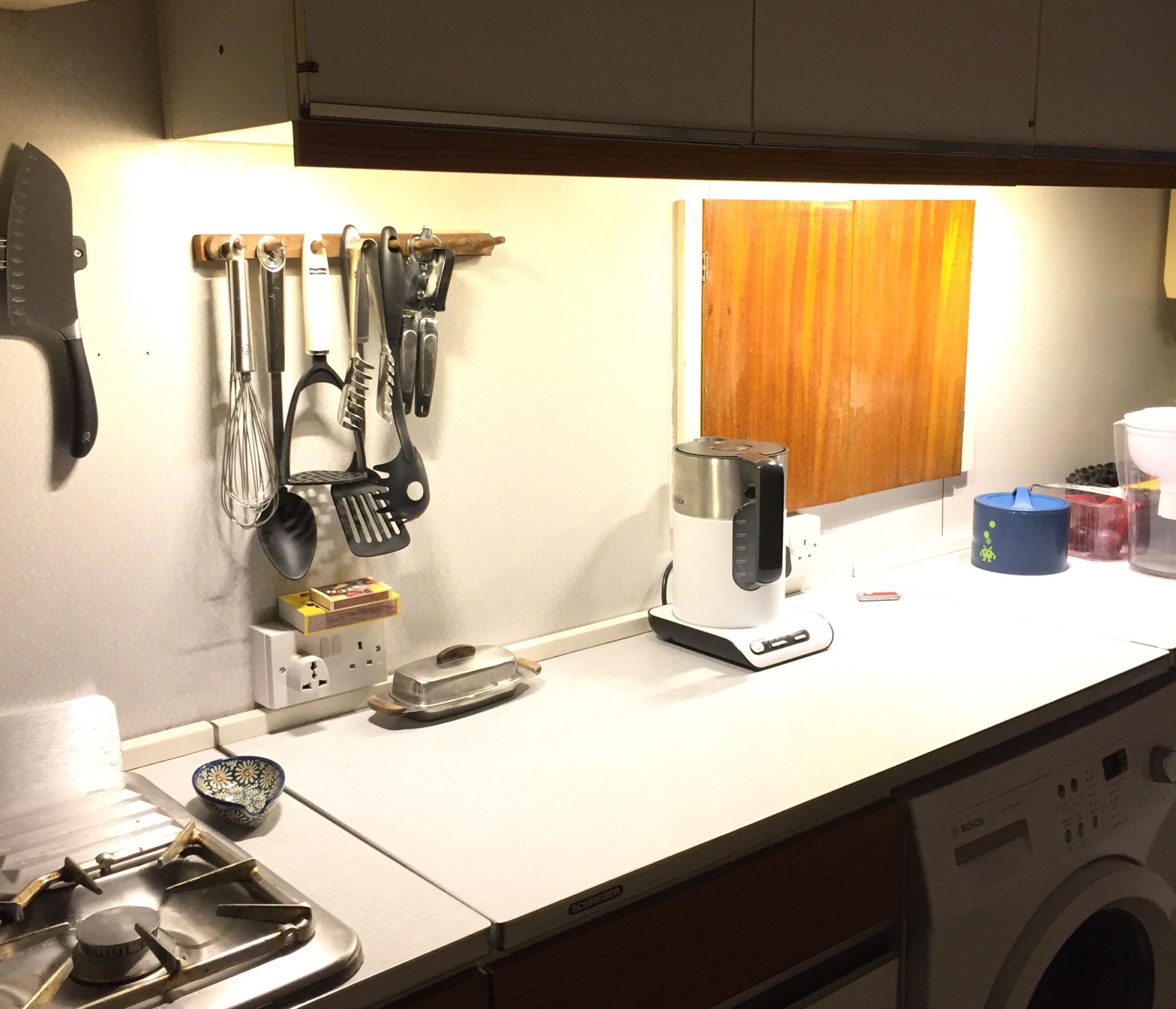 The 1970s kitchen countertop is now well-lit...